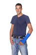 man with blue arm bandage