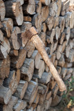 An ax sticking out in the woodpile poster