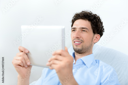 Man looking on digital tablet