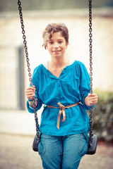 Young Girl Playing on the Swing