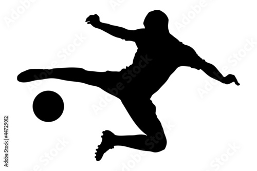 A silhouette of a soccer player shooting a ball