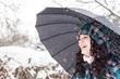 Girl with umbrella in the snow