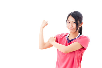a beautiful asian woman showing muscle on white background