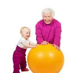 Grandmother and baby with pilatses ball