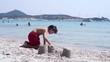 Child building sand castle