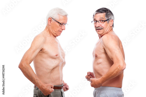 Two seniors comparing figure