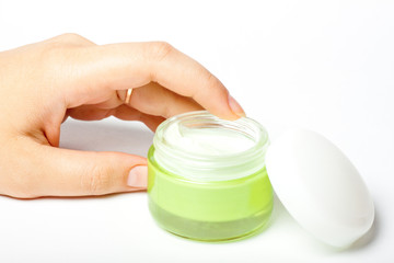 moisturizer and female hand