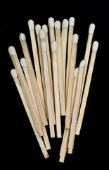 A bunch of wooden matches isolated on a black background