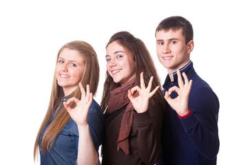 Teenage Students Making Ok Sign