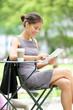 Business woman using tablet on break