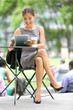 Businesswoman on break in park