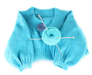 Blue sweater and a ball of wool isolated on white