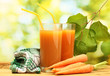 glasses of carrot juice and fresh carrots