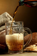 kvass poured into a mug  and rye breads with ears,