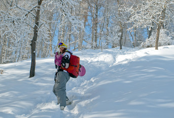 Sport women going for freeride with snowboard