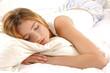 Beautiful woman lying and sleep on bed