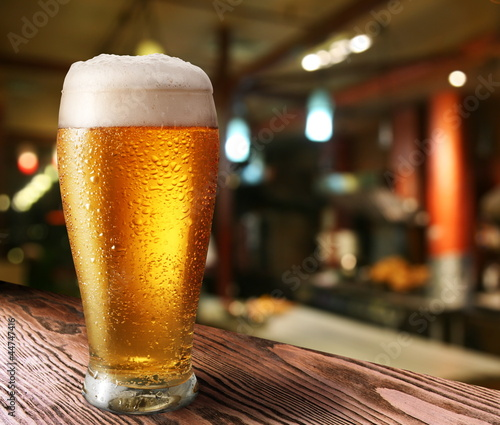 Plexiglas Bar Glass of light beer