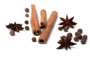 Black peppercorns, anise stars and cinnamon sticks