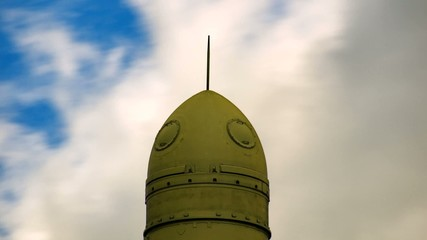 clouds over topol-m missile at military museum, timelapse