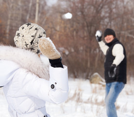 Couple playing snowball
