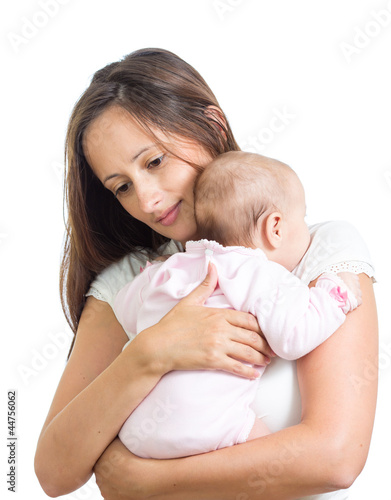 loving mother hugging her baby isolated on white background