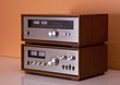 Vintage hi-fi Stereo Amplifier and tuner in wooden cabinets