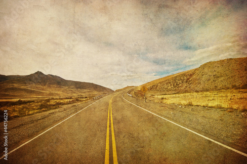 grunge image of highway and blue sky