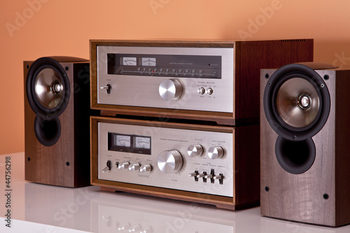 Vintage hi-fi Stereo Amplifier tuner and speakers in wooden cabi