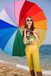 Teenage girl carrying iridescent  umbrella