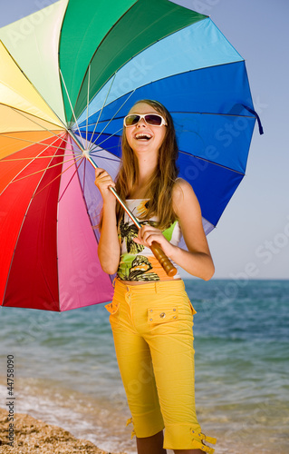Teenage girl carrying iridescent  umbrella