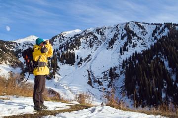 Climbing young adult looking through binoculars