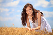 Cute girl in wheat field