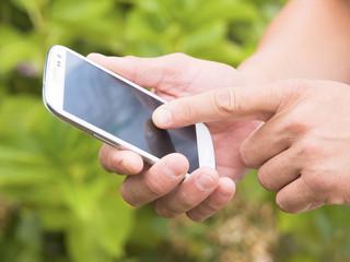 Man hand touching screen on modern mobile smart phone