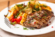Pork steak with pan-cooked vegetables and fresh herbs