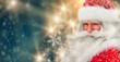 Leinwanddruck Bild Santa Claus portrait smiling in snowfall