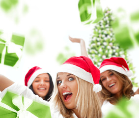 Excited attractive three women with many gift boxes and bags fal
