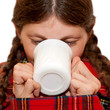 Cold, sick and wrapped in plaid tartan woman drinking a cup