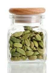 Jar of cardamom isolated on white close-up