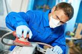 auto mechanic polishing car