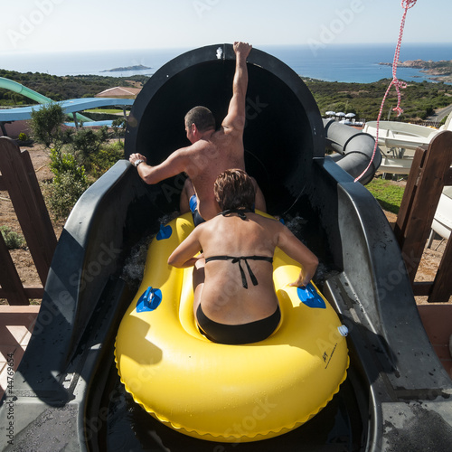people who slip from the water park slides de Eugenio Marongiu, Photo