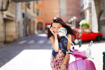 woman and motorbike