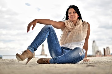 Portrait of beautiful young woman in jeans