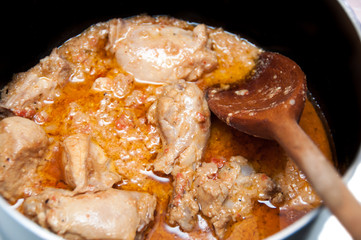 Close up of Chicken curry masal being cooked in a pan