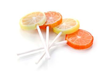 fruit lollipops isolated on white