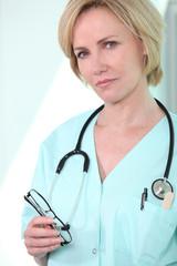 Nurse holding glasses