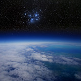 High altitude view of the Earth in space and the Pleiades.