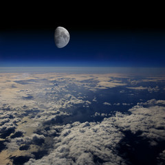 The Earth in space and the Moon.