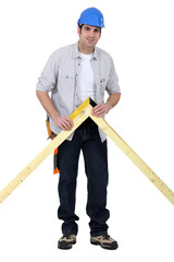 Carpenter checking wooden joint