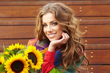 Autumn fashion woman with flowers