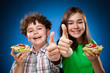 Kids eating big sandwich showing OK sign